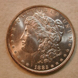 1885 US Morgan Silver Dollar Choice UNC bright white with golden rims