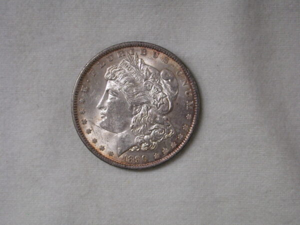 1890 US Morgan Silver Dollar Uncirculated UNC with golden toned rims