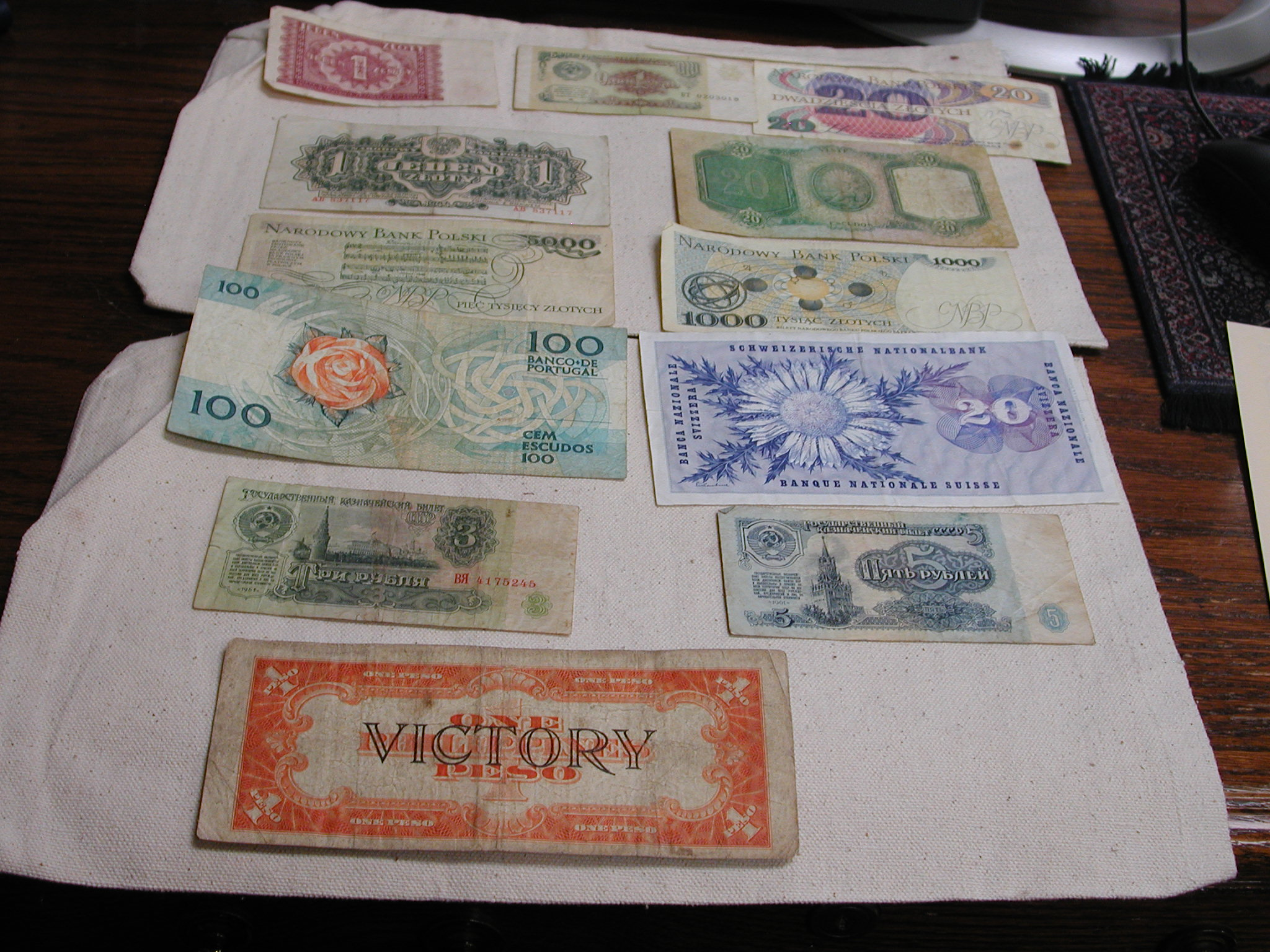 World currency 12 items Poland Phillippines Portugal Swiss 2