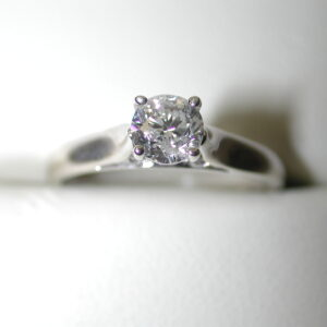14KT Solitaire .72 tw round Diamond Macy's ring size 7 with surprise diamonds