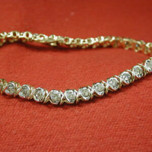 14KT diamond X O tennis bracelet 1 3/4 carat two tone