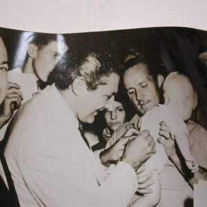 Liberace signing autographing baby old original photo