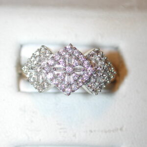 14KT diamond cluster ring size 7 with 1 carat round/rectangle diamonds